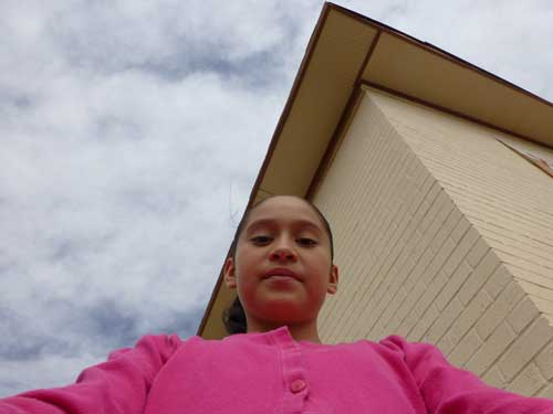 Selfie from a low angle, by Adriana